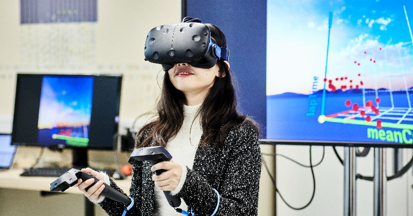 A researcher wearing a VR headset in one of our laboratories